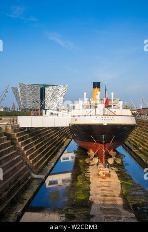 United Kingdom, Northern Ireland, Belfast, The SS Nomadic - Tender to the Titanic and the last remaining White Star Line ship infront of the Titanic Belfast museum - Stock Photo