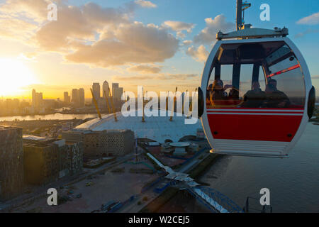 UK, England, London, O2 Arena (formerly Millennium Dome) and Canary Wharf skyline from the Emirates Air Line or Thames Cable Car over River Thames, from Greenwich Peninsula to Royal Docks - Stock Photo