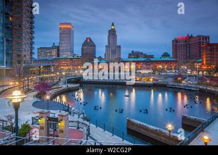 USA, Rhode Island, Providence, city skylline from Waterplace Park, dusk - Stock Photo