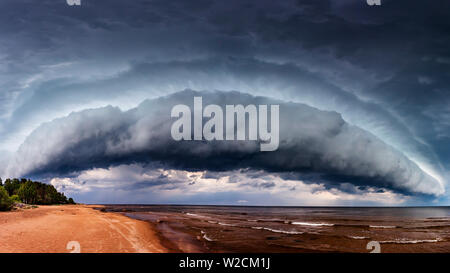 Dramatic Storm Clouds over sea - Stock Photo