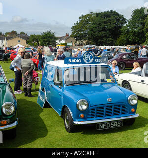 1961 commercial motorcar (Austin Mini Van RAC Radio Rescue) on display & people visiting Classic Vehicle Show - Burley-In-Wharfedale, England, UK. - Stock Photo