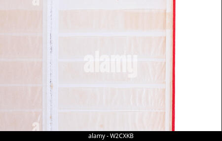 Closed old book for postage stamps isolated on white background - Stock Photo