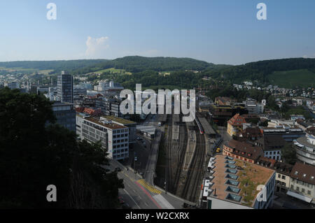 Switzerland: The view to the train station of the old town of Baden City and the industrial zone in canton Aargau from the chateau above - Stock Photo