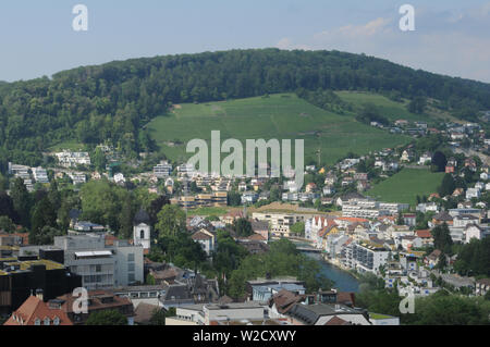 Switzerland: The view to the old town of Baden City and Ennetbaden in canton Aargau from the chateau above - Stock Photo