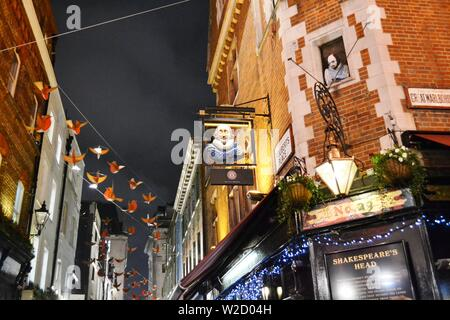 London/UK - November 28, 2013: Close-up view Shakespeare's head pub in the Carnaby street decorated for Christmas with red birds to feel happiness. - Stock Photo