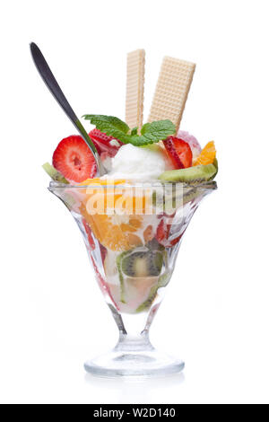 ice cream sundae: A fruit cup with cones and a spoon isolated on white background - Stock Photo