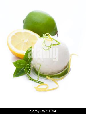 ice cream sundae: A scoop of lemon sorbet isolated on white background - Stock Photo