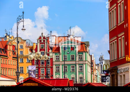 Wroclaw, Poland - June 21, 2019: Old Town Rynek Market Square with street light and colorful houses - Stock Photo