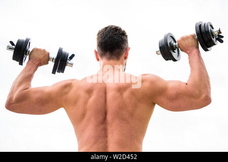Actions speak louder than coaches. Dumbbell exercise gym. Muscular man exercising with dumbbell rear view. Sportsman with strong back and arms. Sport equipment. Bodybuilding sport. Sport lifestyle. - Stock Photo
