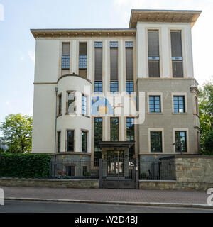 Frankfurt am Main, July 2019.  a historic house with a sundial on its facade - Stock Photo