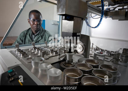 Mining titanium mineral sands. Materials Separation Process Plant. Laboratory chemist determines amount of concentrate of elements in ilmenite sample. - Stock Photo