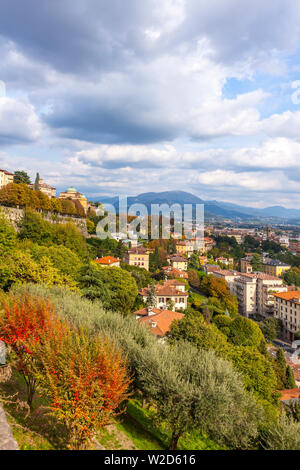 Picturesque aerial view of Bergamo city, Lombardy, Italy. Bergamo Alps (Alpi Orobie) begin immediately north of the city, on the background - Stock Photo