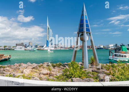 The Tide Clock designed by Paul Best on the waterfront at Gosport in Hampshire, overlooking Portsmouth Harbour and the landmark Spinnaker Tower. - Stock Photo