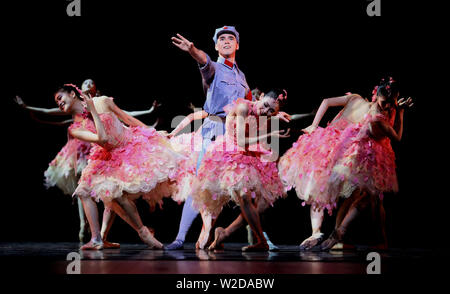 (190708) -- SHIJIAZHUANG, July 8, 2019 (Xinhua) -- Dancers of Shanghai Ballet perform during a ballet drama called 'Sparkling Red Star' to celebrate the 70th anniversary of the founding of the People's Republic of China at Hebei Arts Center in Shijiazhuang, capital of north China's Hebei Province, July 7, 2019. Produced and performed by the Shanghai Ballet, the drama presents the story of a young Red Army soldier Pan Dongzi, who fought for his faith and fellow people, after his heroic childhood. (Photo by Liang Zidong/Xinhua) - Stock Photo