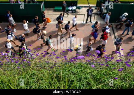 Wimbledon, London, UK. 8th July 2019, The All England Lawn Tennis and Croquet Club, Wimbledon, England, Wimbledon Tennis Tournament, Day 7; Fans arrive at the Wimbledon grounds Credit: Action Plus Sports Images/Alamy Live News - Stock Photo