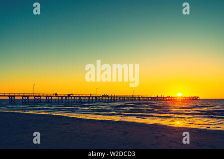 Semaphore Beach  jetty with people at sunset - Stock Photo