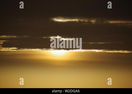 Golden Winters Sunrise with Gloomy Stratus Cloud. Aberdeen, Scotland, UK. - Stock Photo