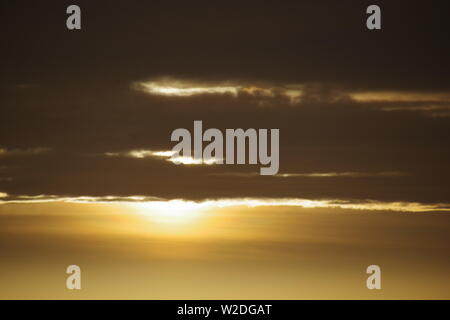 Golden Winters Sunrise with Gloomy Stratus Cloud. Aberdeen, Scotland, UK. - Stock Photo
