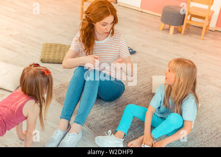 Nice good looking woman speaking with a girl - Stock Photo