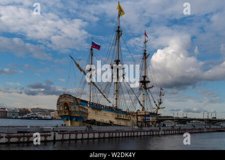 Snkt-Peterbrug, Russia - July 6, 2019: Sail Ship 'Poltava' on embankment of Neva river. Sankt-Peterburg, Russia - 'Poltava' it is historical reconstru - Stock Photo