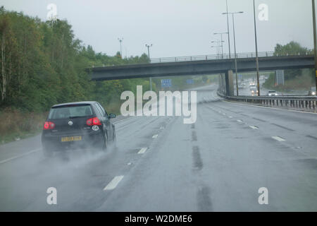 Treacherous road conditions on M5 with heavy rain, UK - Stock Photo
