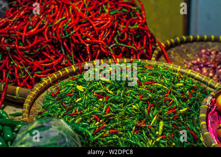 Red hot and green chili nice ingredients for cooking needs in traditional market - Stock Photo