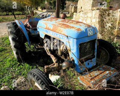 Weathered Leyland tractor. - Stock Photo