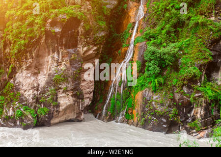 Beautiful mountains landscape with waterfall and river in Nepal, Annapurna trekking - Stock Photo