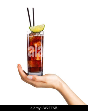 Woman hand holding cocktail in tall glass on white background - Stock Photo
