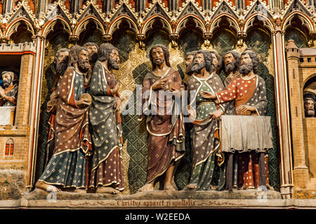 Carved wall with Apparition to the Apostles in the upper room at Cathedrale Notre Dame de Paris in France. - Stock Photo