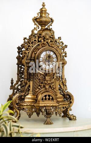Antique mechanical clock made of metal - Stock Photo
