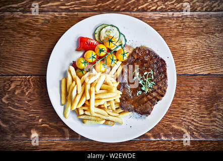 Beef barbecue steak with french fries - Stock Photo