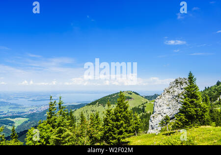 View on the Lake Chiemsee in Bavaria in summer from the Kampenwand Massive - Stock Photo
