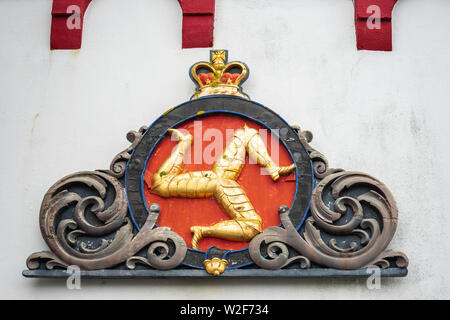 Castletown, Isle of Man, June 15, 2019. A triskelion, composed of three armoured legs with golden spurs, upon a red background. The national symbol of - Stock Photo