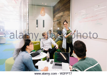 Compute programmers meeting in creative office - Stock Photo