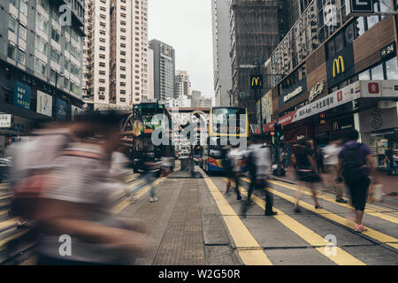 Causeway Bay, Hong Kong, 08 July 2019: Commuter in busy crosswalk, Causeway Bay. Causeway Bay is one of the most attractive areas for tourists and bus - Stock Photo