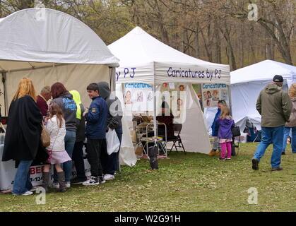 Meriden, CT USA. Apr 2019. Daffodil Festival. Vendors selling their goods. - Stock Photo