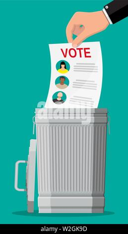 Hand puts election bill in trash - Stock Photo