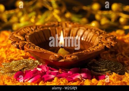 Close up of burning diwali diya - Stock Photo
