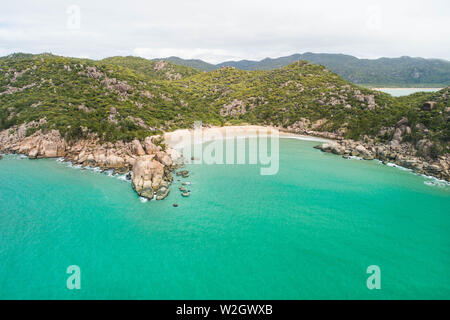 Aerial views over a tropical island in a middle of an archipelago. Drone shots over Magnetic island in north queensland and near the great barrier ree