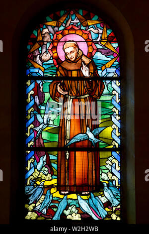 Saint Joseph's church, Nazareth, Galilee, Israel. Stained glass depicting St Francis of Assisi. - Stock Photo