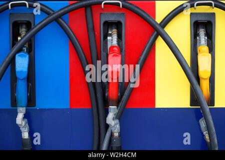 Three fuel nozzles at a gas station. Kep. Cambodia. - Stock Photo