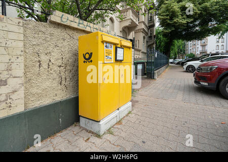 Frankfurt am Main, July 2019.  the box lettes of the German post office on a sidewalk in the city - Stock Photo