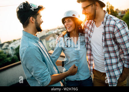 Group of friends partying on terrace - Stock Photo