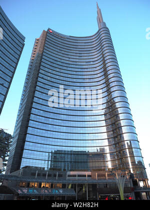 Europe , Italy, Lombardy, Milan, Gae Aulenti square at dusk with Unicredit Towers designet by Cesar Pelli - Stock Photo