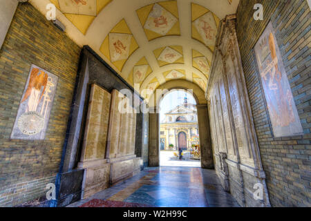 Italy, Lombardy, Varese, Arco Mera, San Vittore Martire Basilica in background - Stock Photo