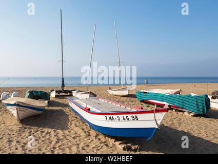 La Cala de Mijas, Costa del Sol, Malaga Province, Andalusia, southern Spain.  Fishing and leisure boats on empty beach. - Stock Photo