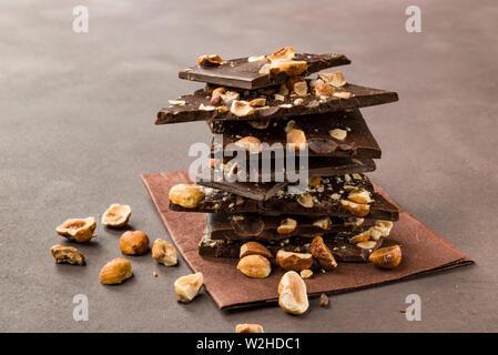 hazelnut dark chocolate pieces on brown background