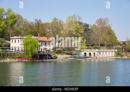 TURIN, ITALY - MARCH 31, 2019: Armida Rowing Club building and terrace with people, Po river in Piedmont, Turin, Italy. - Stock Photo