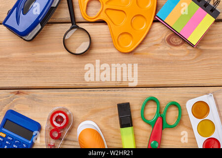 Various school supplies and copy space.